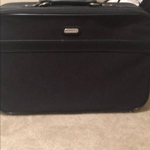 Brand new suitcase and carry bag